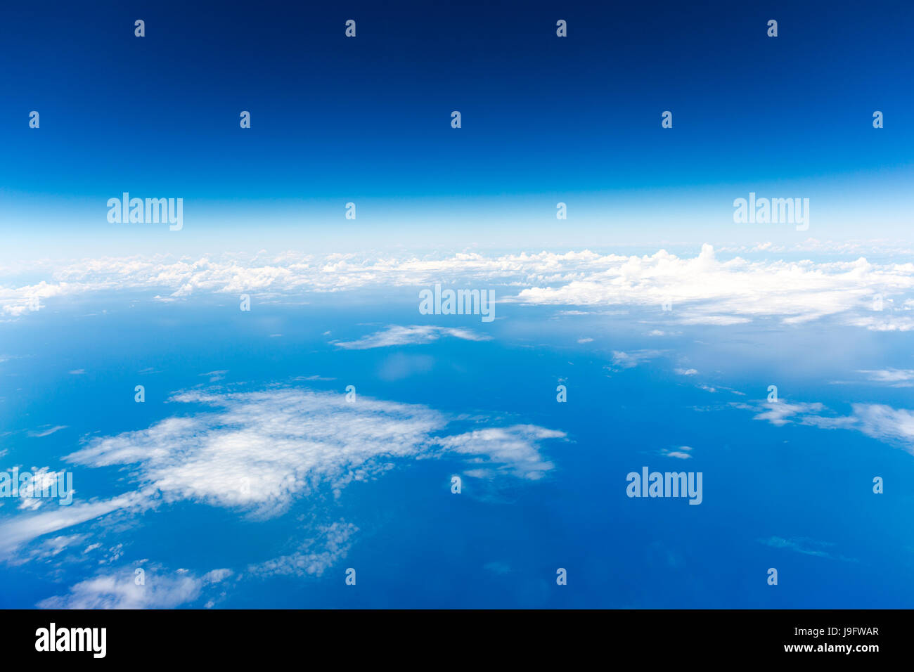 Flight over the Atlantic Ocean. View from airplane window to the clouds over the sea Stock Photo
