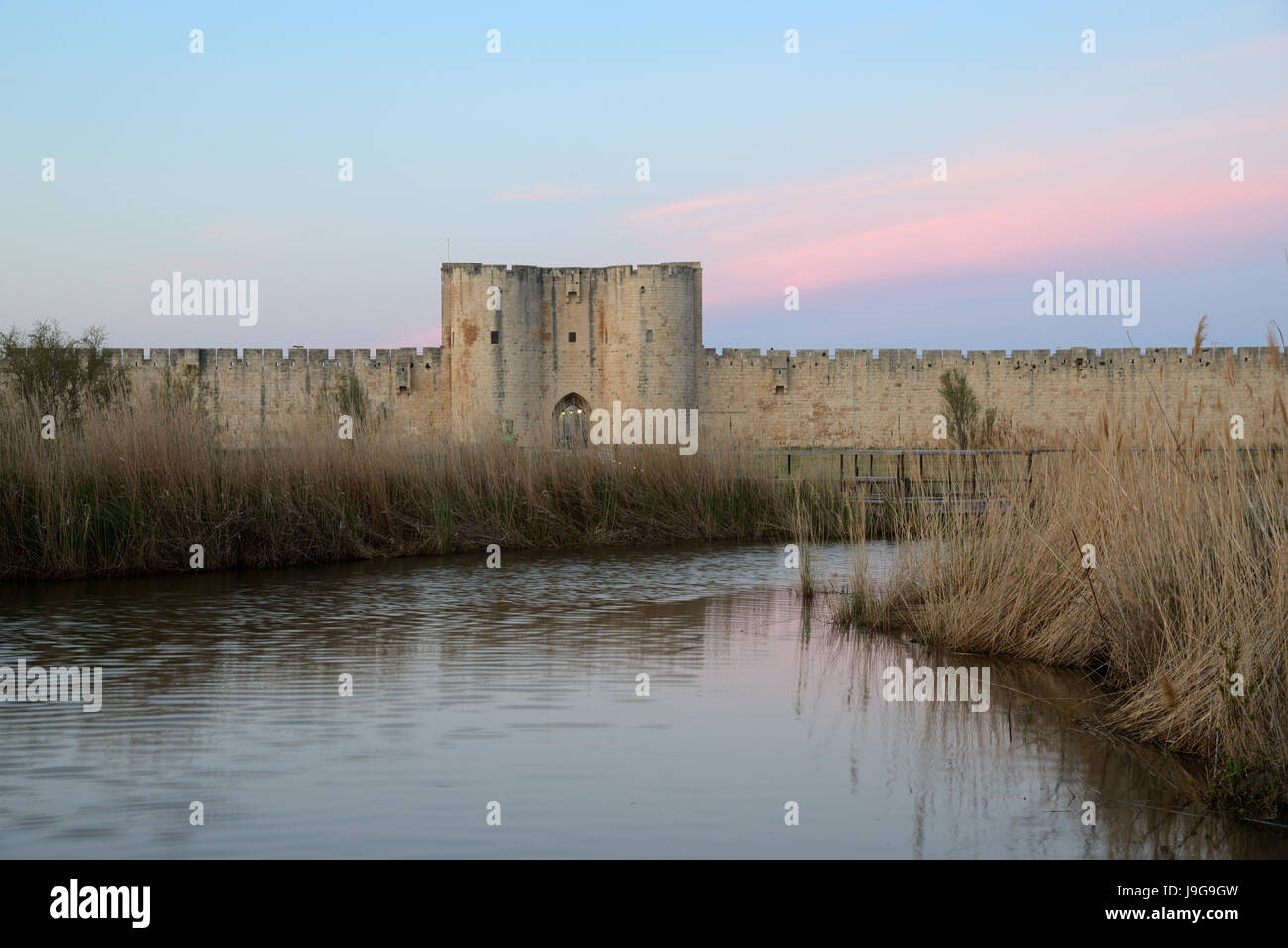 Dusk or Sunset over the Medieval Southern Walls of the Medieval Walled Town of Aigues-Mortes Camargue France - Stock Image