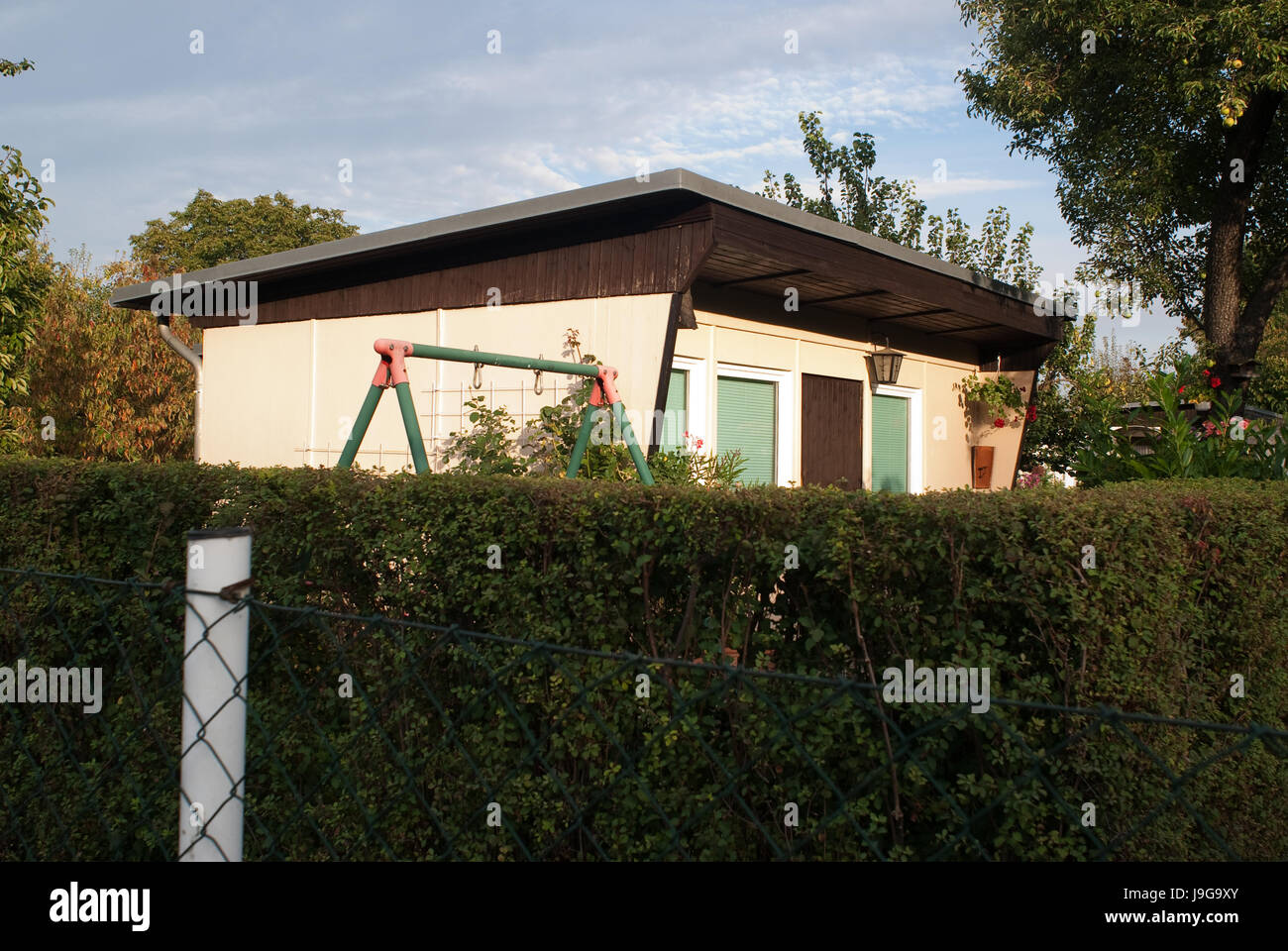 Allotment garden in Berlin. Often called Schrebergarten (German) or simply an allotment, or a community garden. - Stock Image