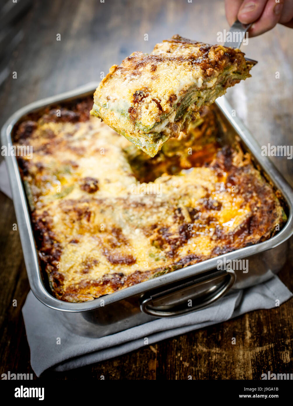 Lasagna bolognese. Typical homemade fresh green pasta cooked in oven. - Stock Image