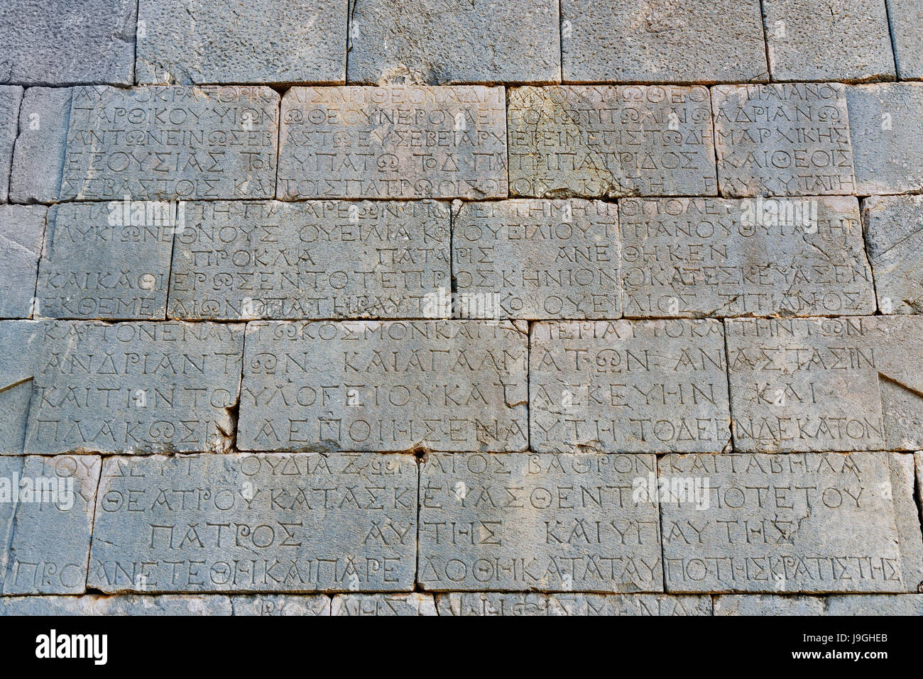 Wall with Greek Script in ruins of amphitheater at ancient Lycian city Patara. Antalya Province. Turkey - Stock Image