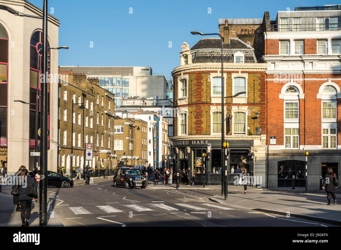 Pedestrian crossing on Beech Street towards Chiswell Street with The Jugged Hare pub / gastropub. City of London, - Stock Image
