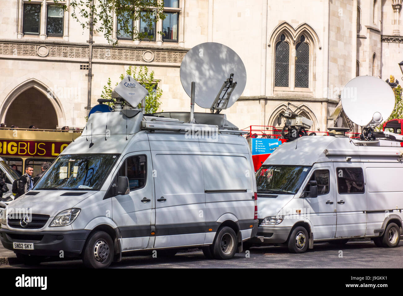 Television (TV) outside broadcast (OB) vans outside Royal Courts of Justice, London, UK - Stock Image