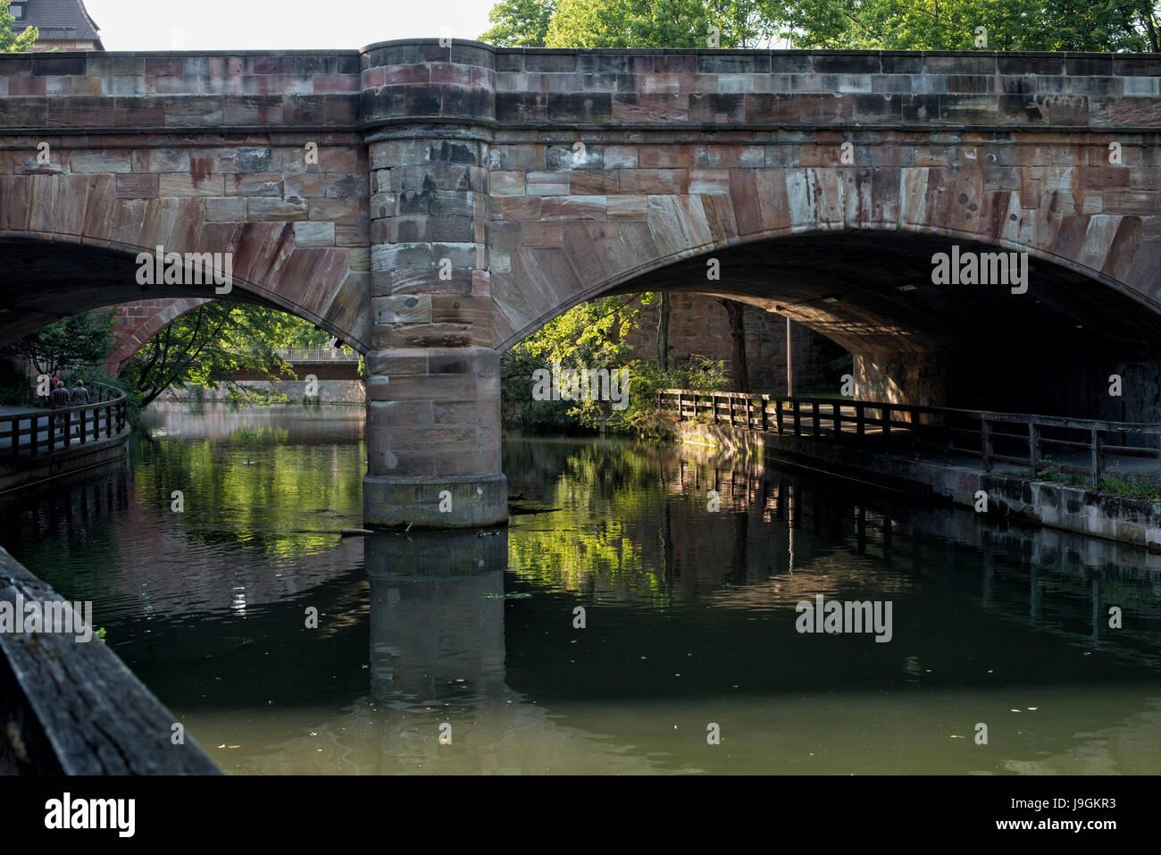 River Pegnitz and Steubenbrücke (Franz-Josef-Strauß-Brücke) in Nürnberg, Nuremberg, Bavaria, - Stock Image