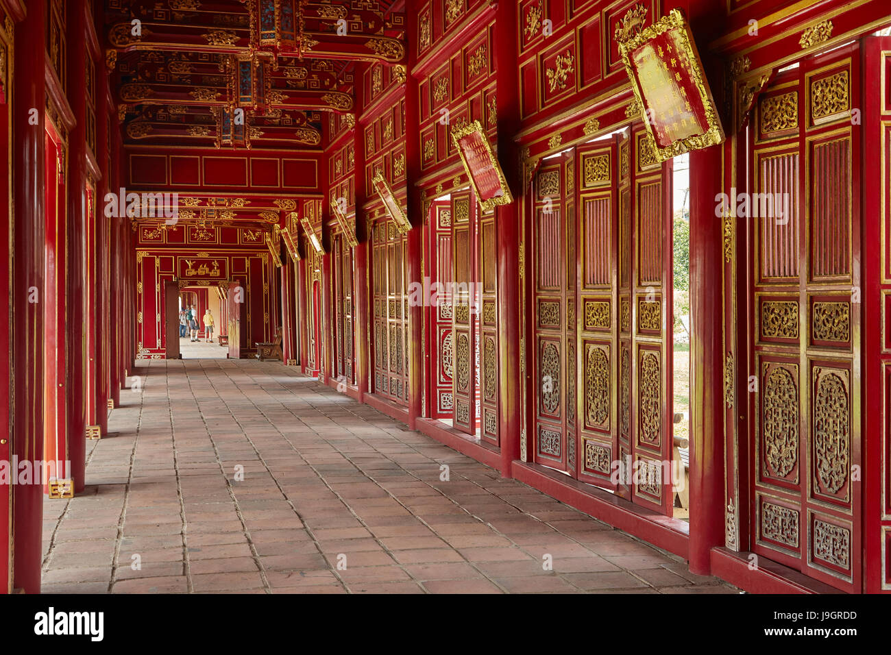 Corridor and red doors in the Forbidden Purple City, historic Hue Citadel (Imperial City), Hue, North Central Coast, - Stock Image