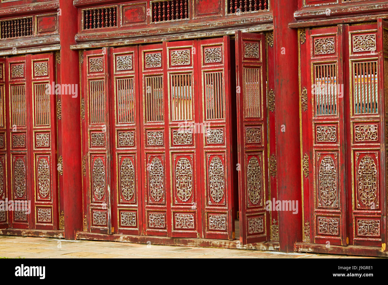 Red doors in the Forbidden Purple City, historic Hue Citadel (Imperial City), Hue, North Central Coast, Vietnam - Stock Image
