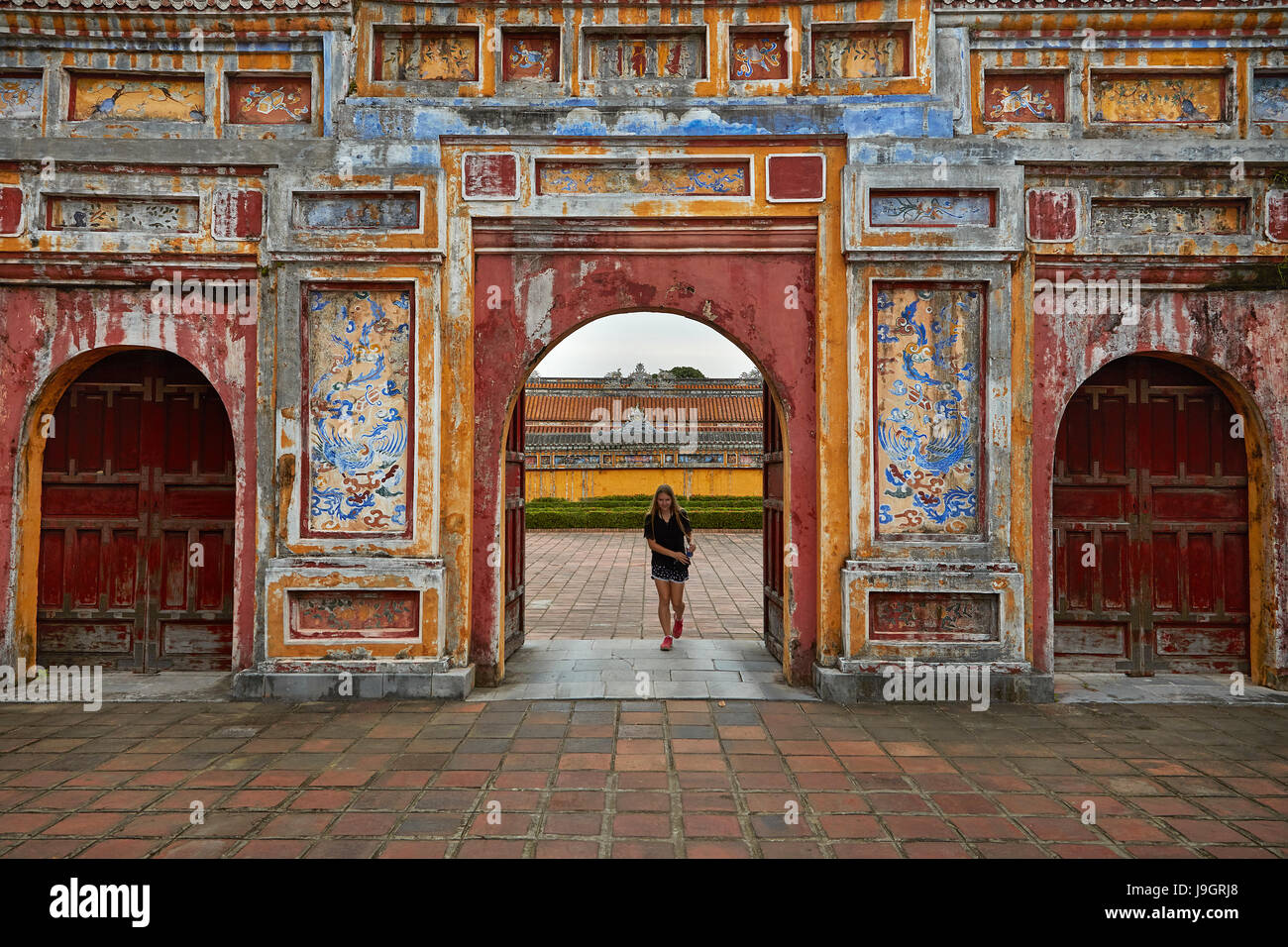 Tourist at Cua Tho Chi gate, historic Hue Citadel (Imperial City), Hue, North Central Coast, Vietnam (MR) Stock Photo