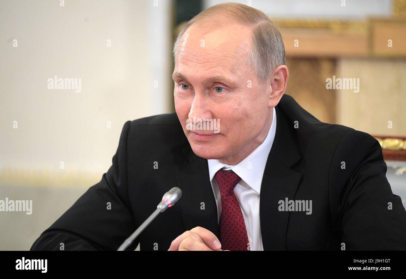 Russian President Vladimir Putin answers questions during the annual meeting with international news organization - Stock Image