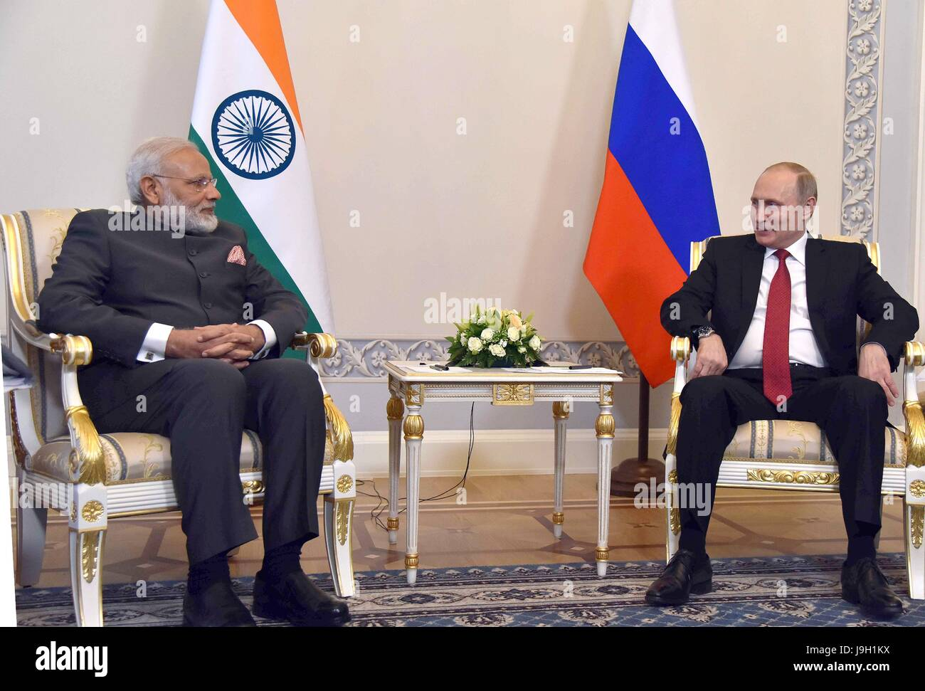 Indian Prime Minister Narendra Modi, left, during a bilateral meeting with Russian President Vladimir Putin at Konstantin - Stock Image