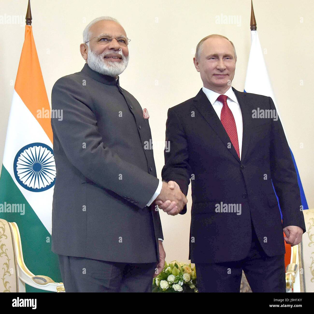 Indian Prime Minister Narendra Modi, left, shakes hands with Russian President Vladimir Putin prior to their bilateral - Stock Image