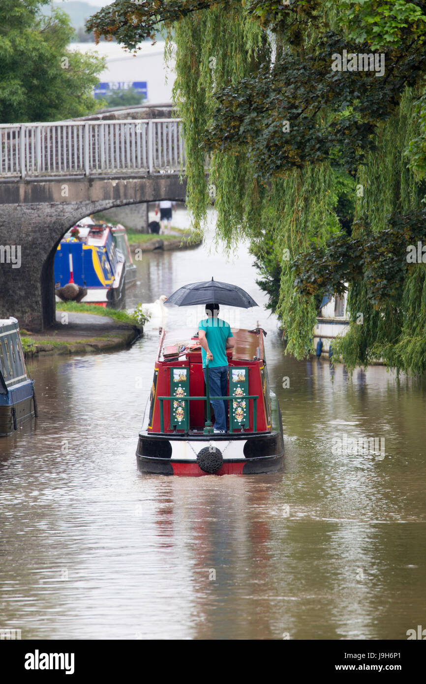 Wet weather for british canal boats travelling along the Shropshire Union Canal in the village of Middlewich, Cheshire, - Stock Image