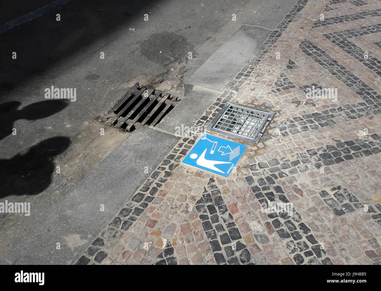 The Prague Municipal Office install the first ashtray into a pavement at Veleslavinova Street in Prague, Czech Republic, - Stock Image