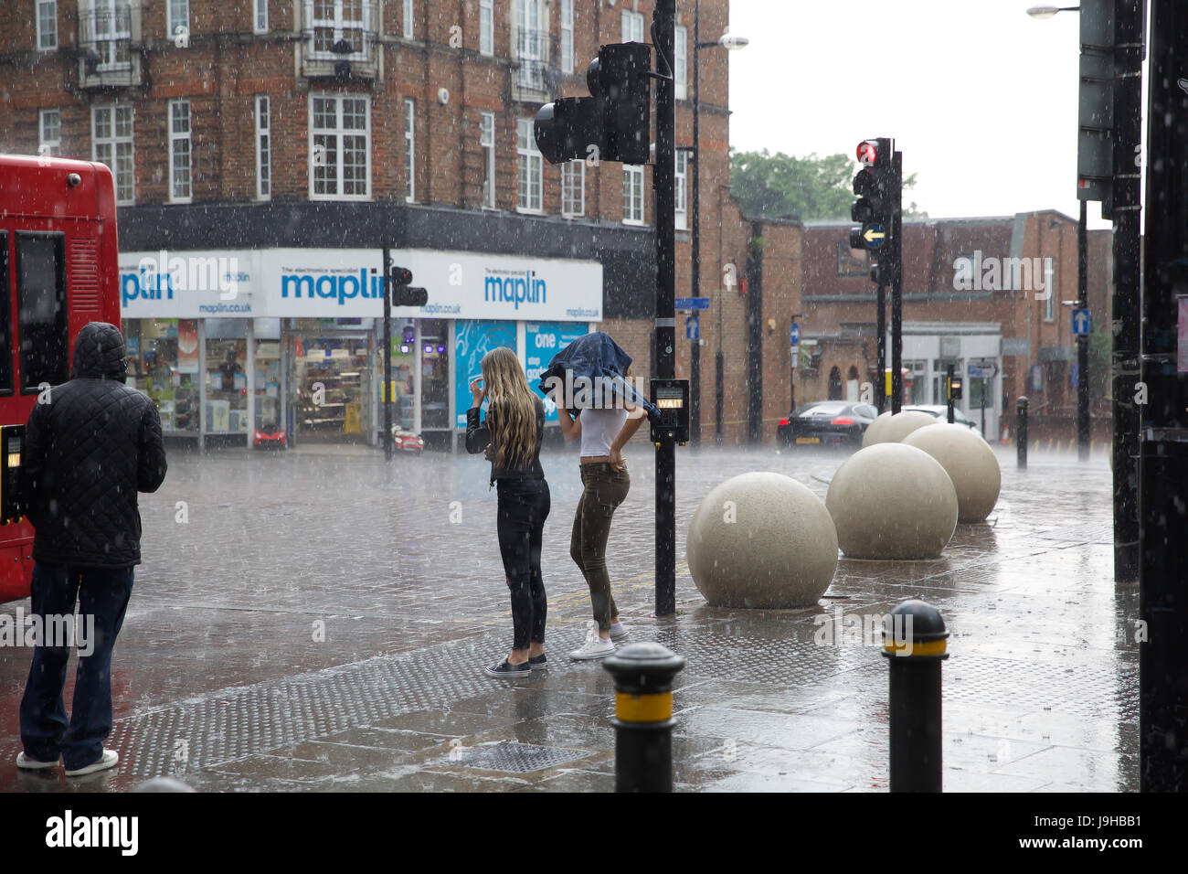 Bromley, UK. 2nd June, 2017. After glorious sunshine this week during half term, Heavy Rainfall sent people running - Stock Image