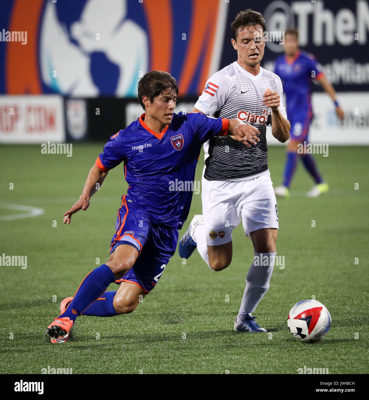May 27, 2017: Miami FC midfielder Calvin Rezende (21) battles for ball possession with Puerto Rico FC midfielder - Stock Image