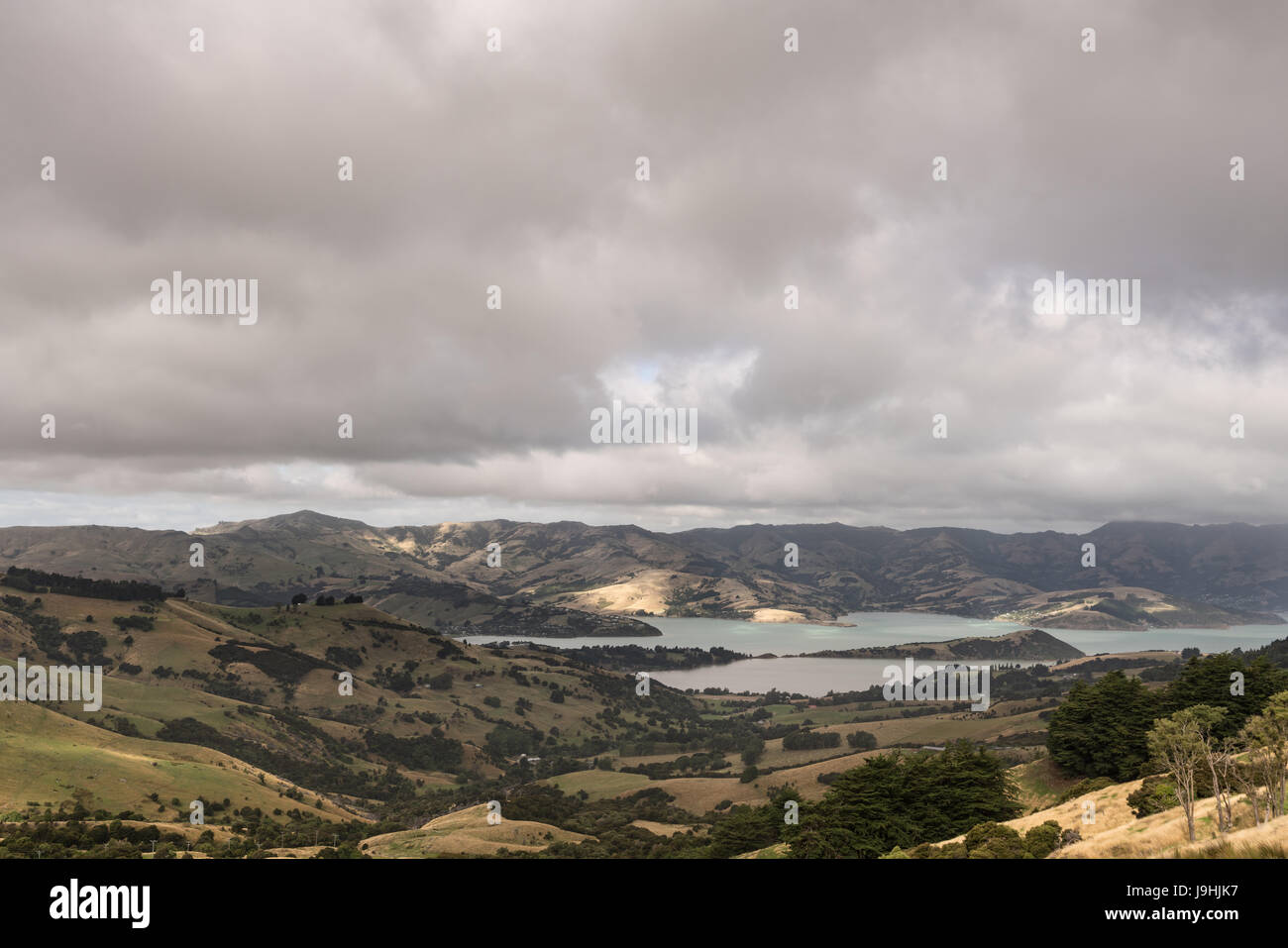 Akaroa, New Zealand - March 14, 2017: The Akaroa Sound is an inlet from Pacific ocean in the remnants of a Miocene - Stock Image