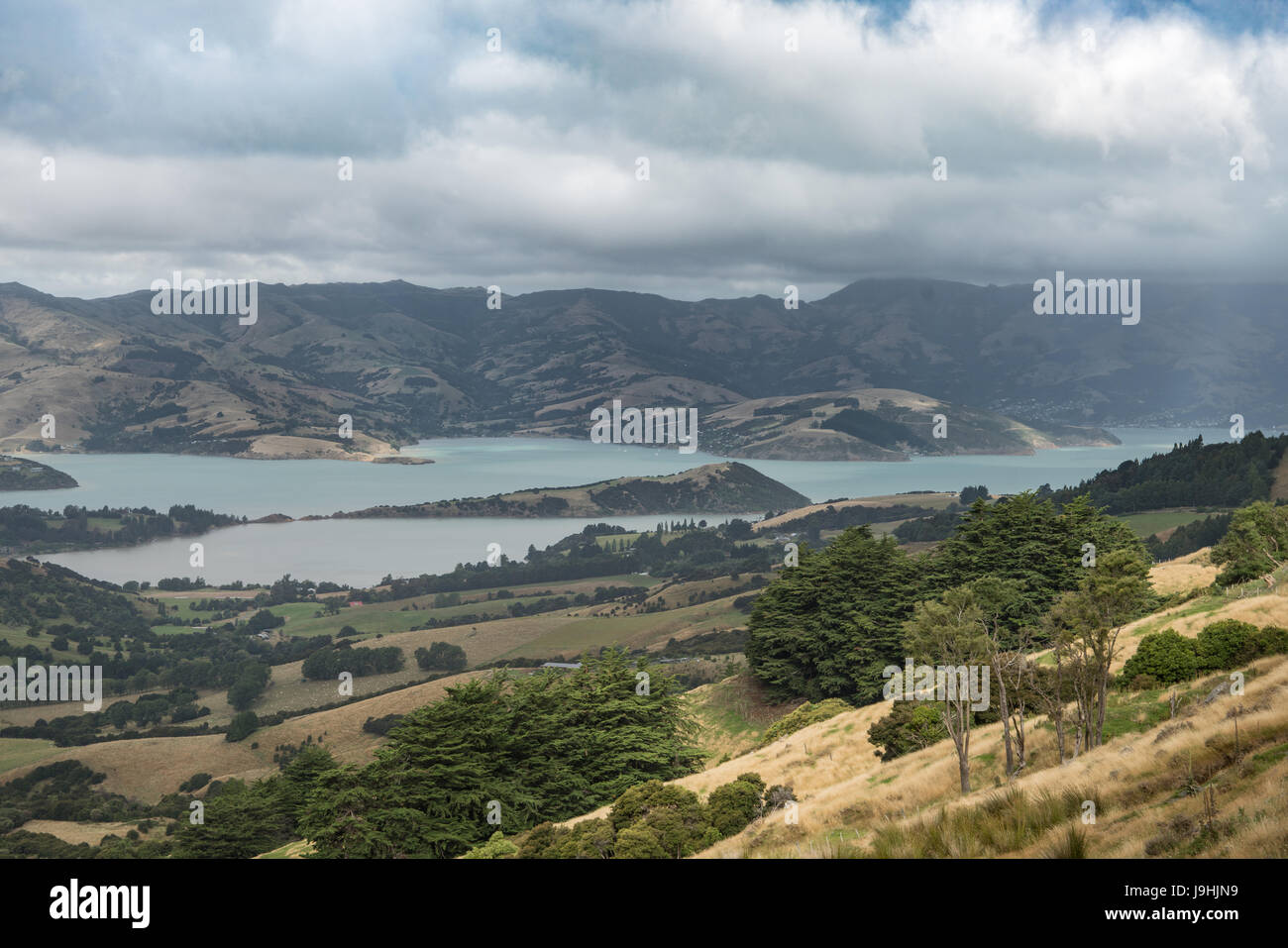 Akaroa, New Zealand - March 14, 2017: Akaroa Sound is inlet from Pacific ocean in remnants of a Miocene volcano. - Stock Image