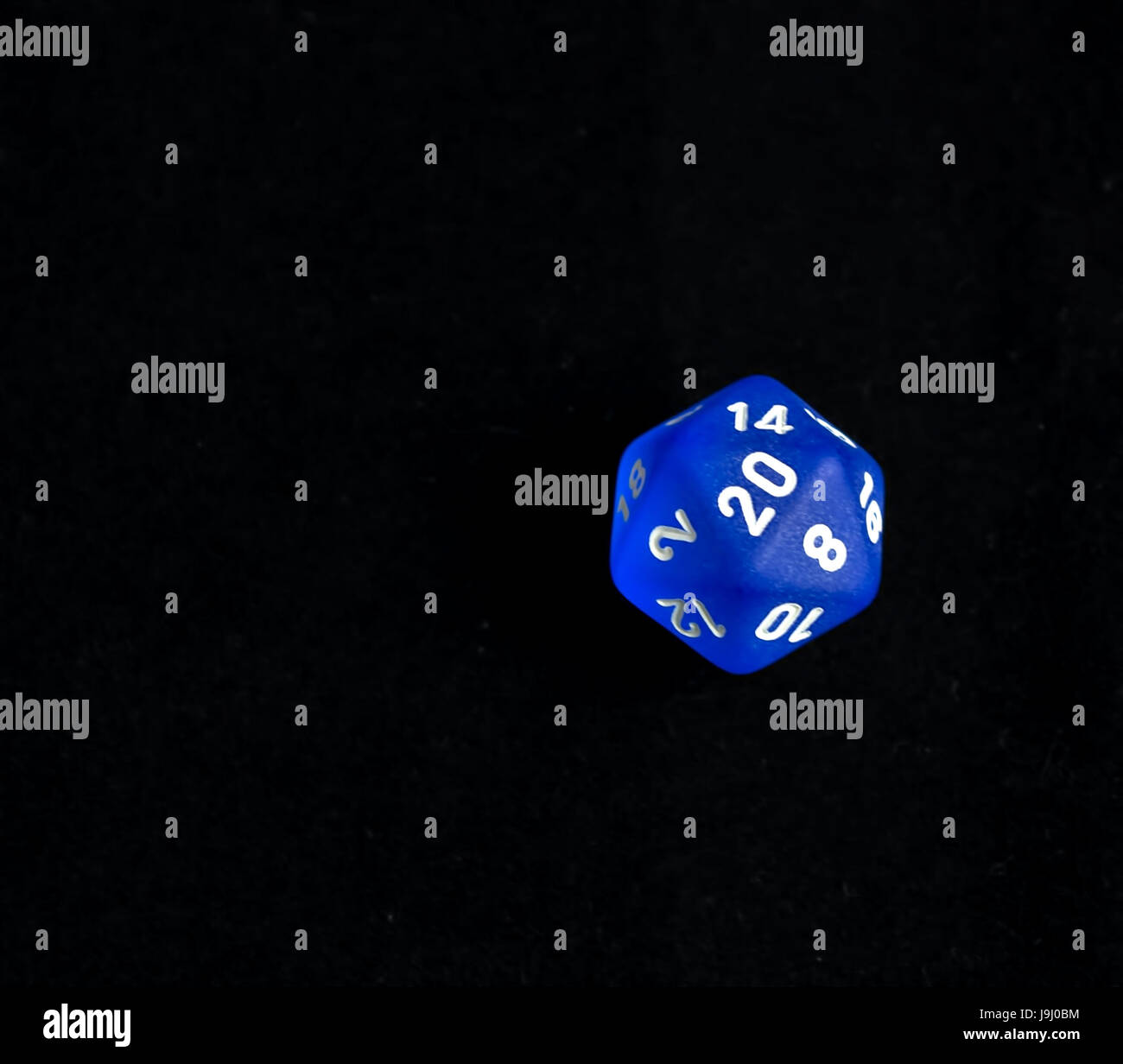 Blue d20 critical success roll RPG polyhedral game dice - Stock Image