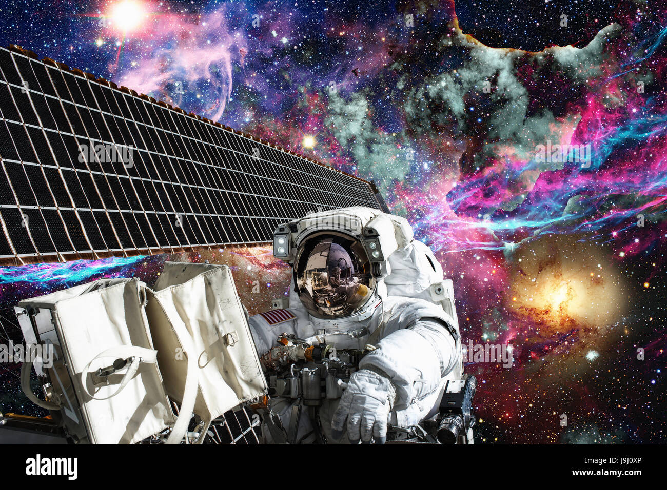 International Space Station and astronaut in outer space over the planet Earth. - Stock Image