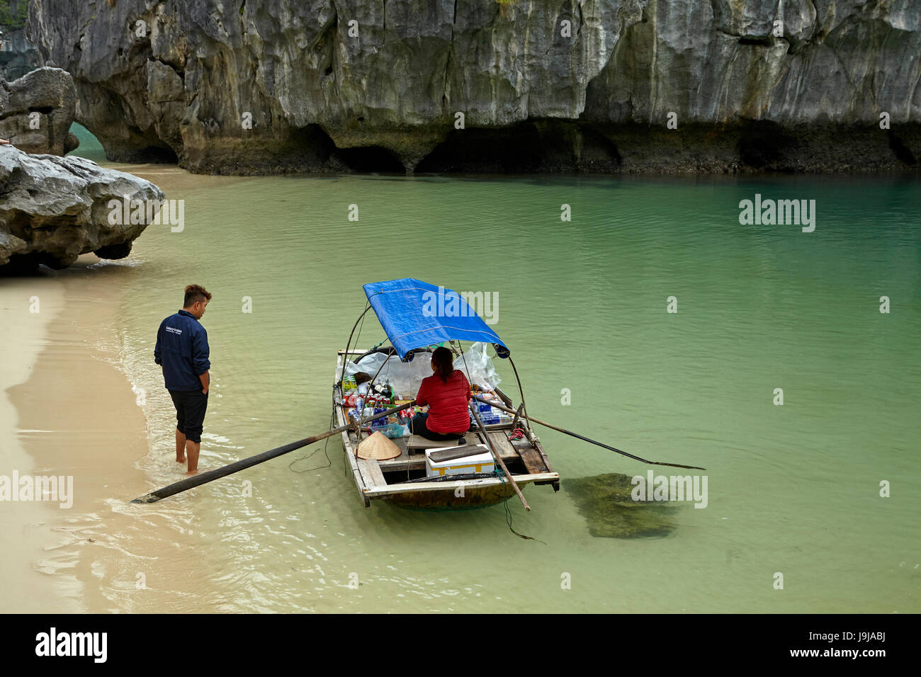 Woman with floating shop, Ha Long Bay (UNESCO World Heritage Site ), Quang Ninh Province, Vietnam - Stock Image