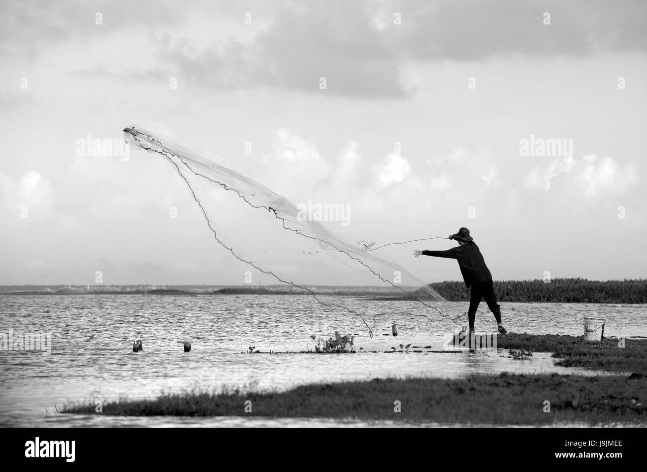 Thailand, Patthalung, Tale Noi, Fisherman with cast net Stock Photo