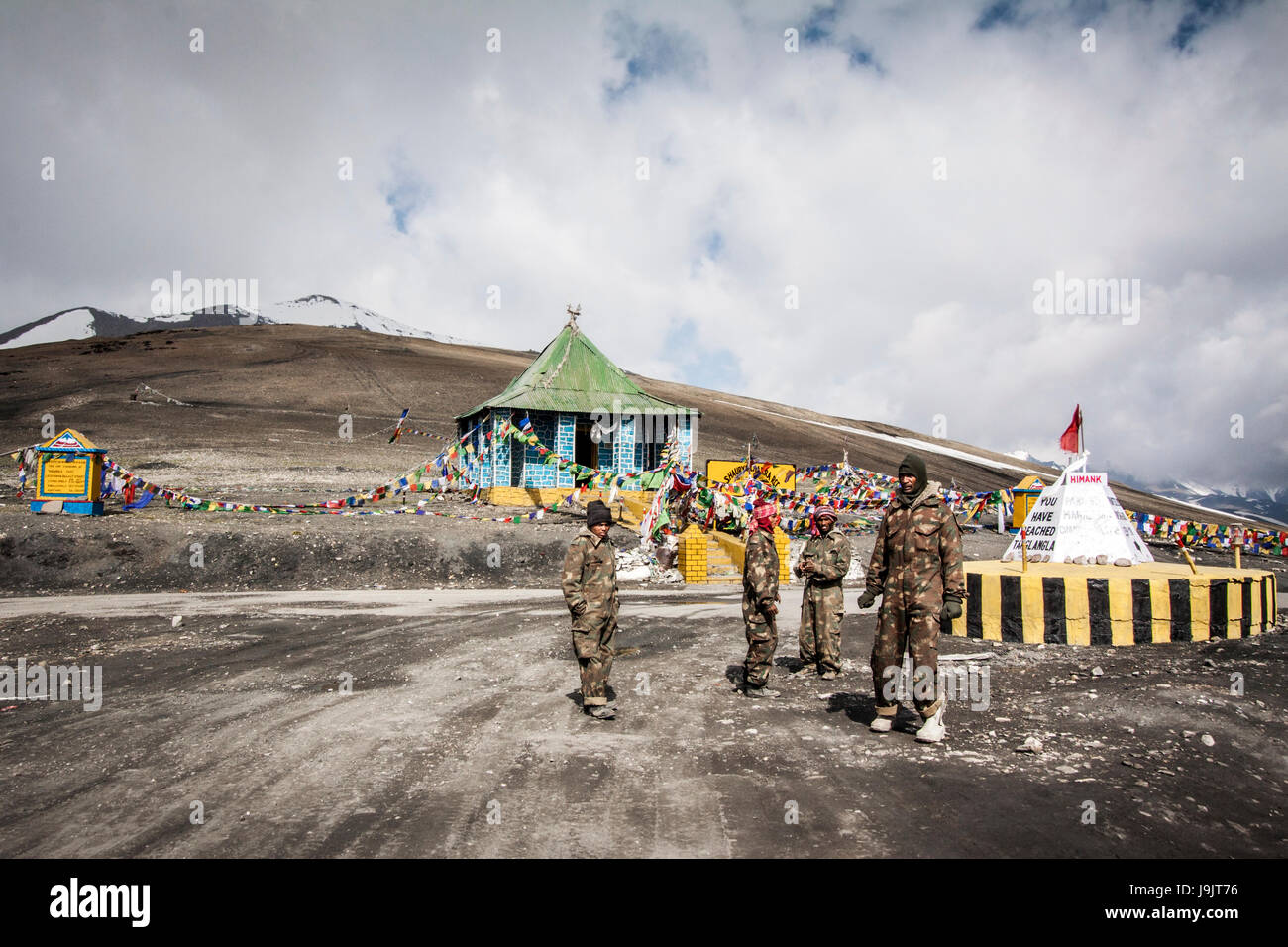 Indian military men posted at Taglang la Pass, at 17,582 ft altitude. Outdoors amidst the Indian Himalaya. One of - Stock Image