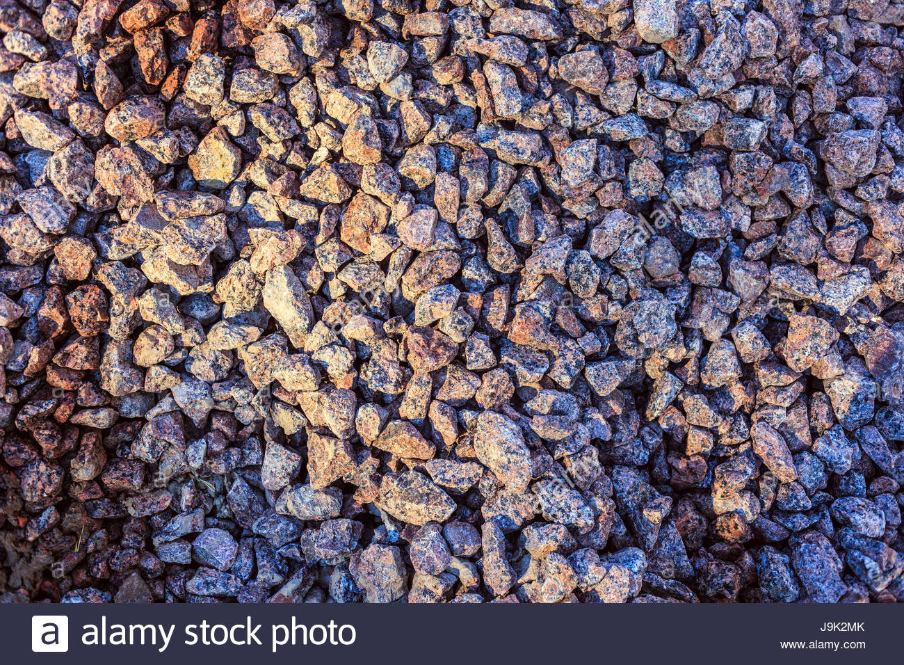 Texture Of Dark Brown Granite Gravel Seamless Tileable