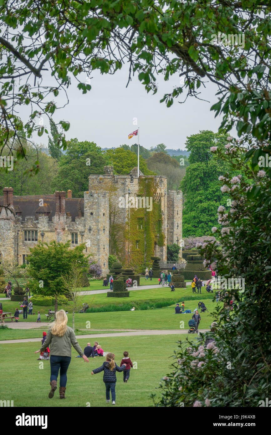 Hever Castle, England -  April 2017 : Mother and daughter walking on the grass in front of the Hever Castle in Kent. - Stock Image