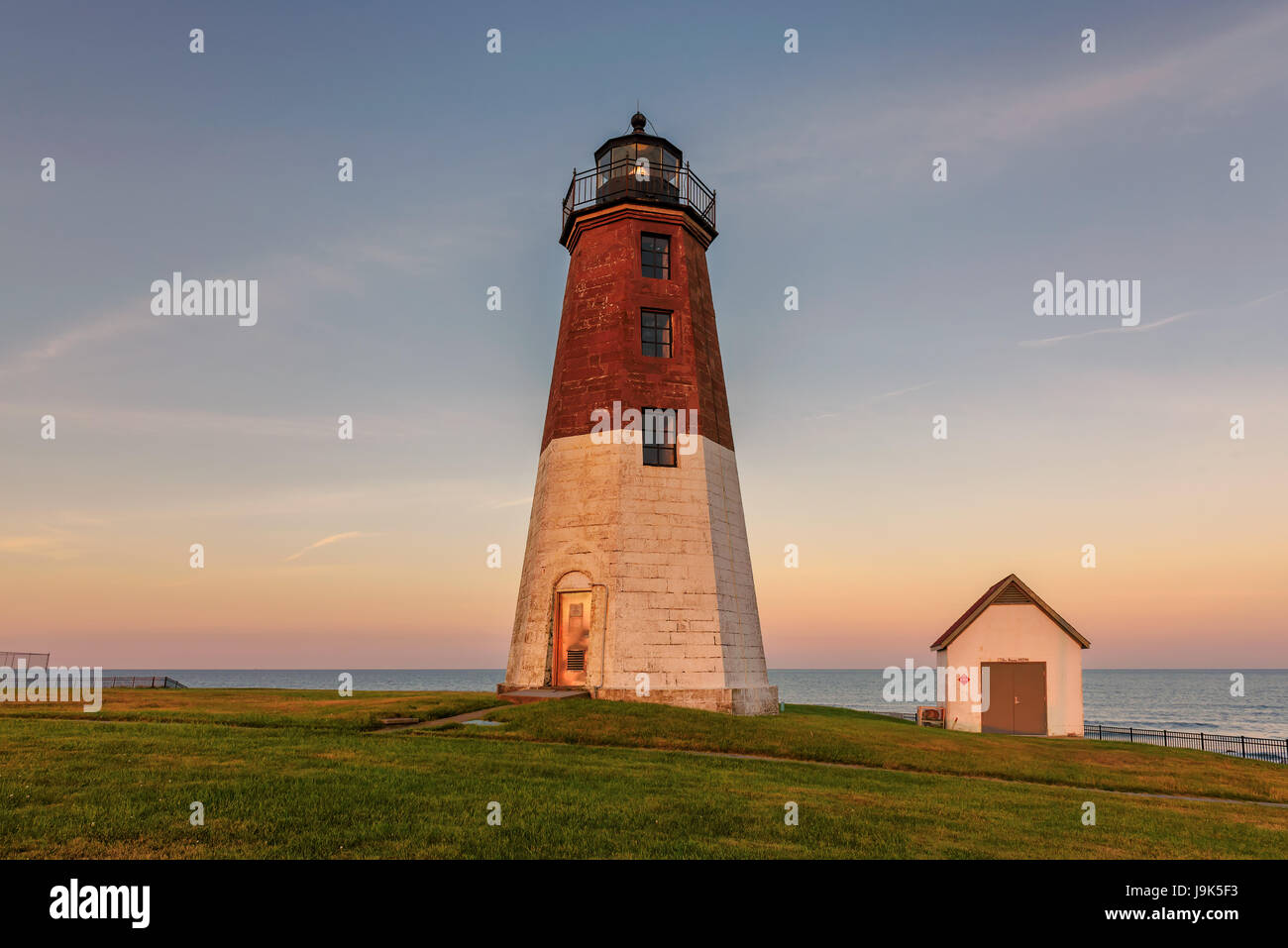 Famous Point Judith lighthouse in Rhode Island at sunset. - Stock Image