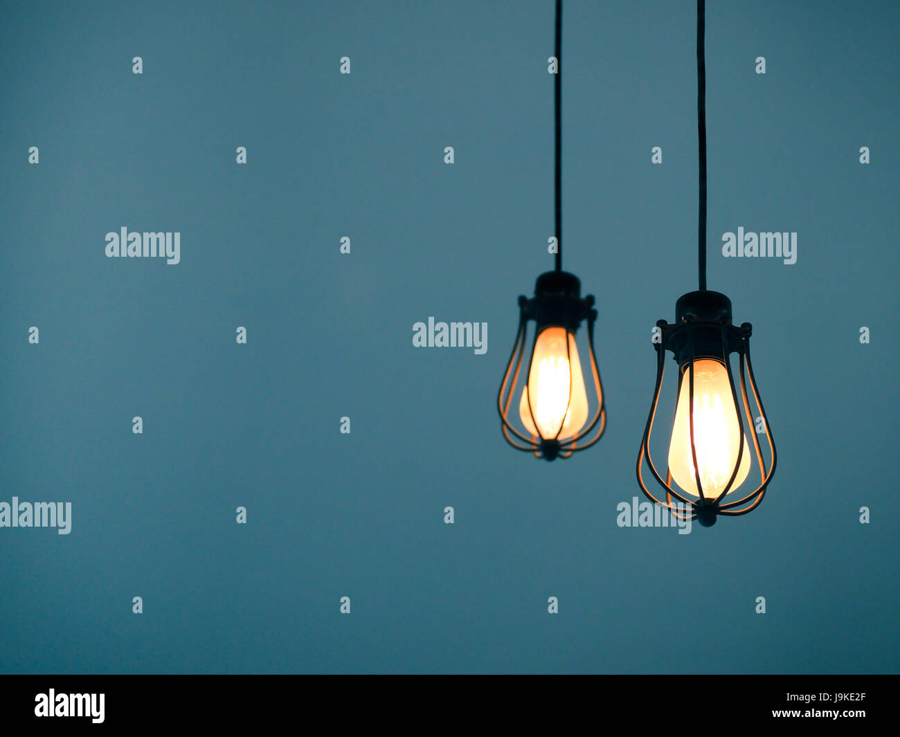 glowing light bulbs on plain background with text space