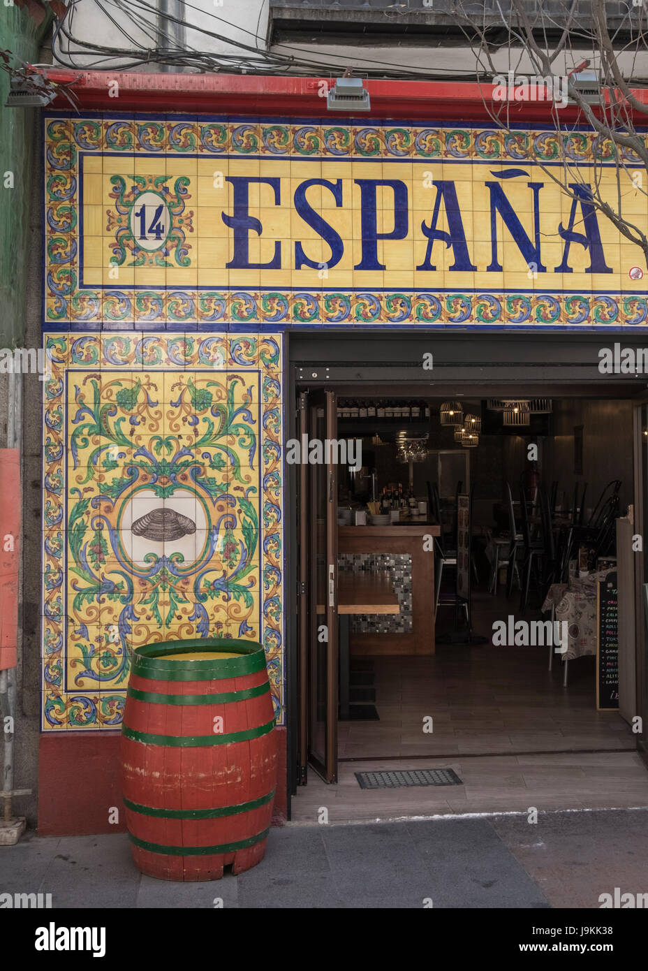 Hand painted decorative tiles used on the exterior of a Spanish restaurant, Madrid, Spain. - Stock Image