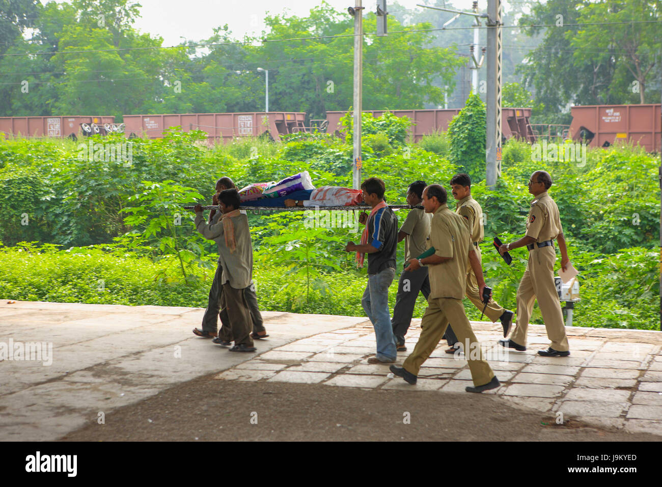 rescue team carrying Rail accident body on stretcher, kalyan, mumbai, maharashtra, India, Asia - Stock Image