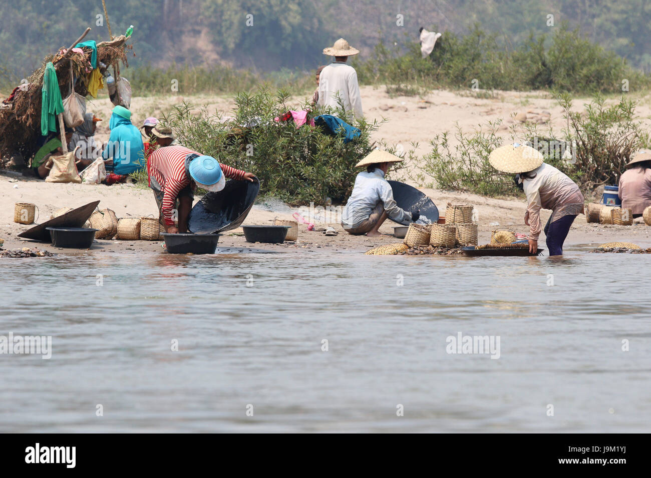 Panning for gold on the Mekong in Laos - Stock Image