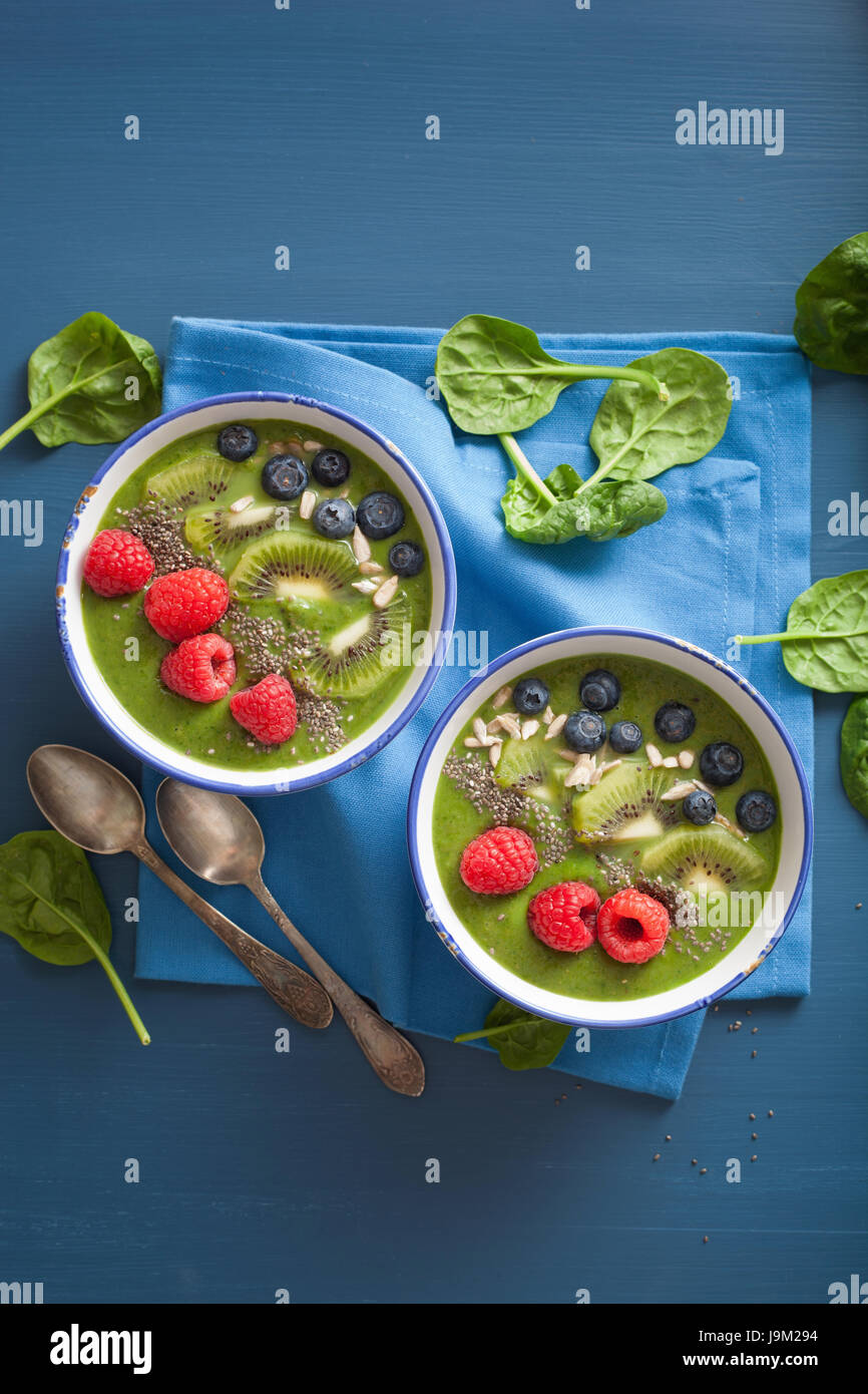 green smoothie bowl spinach kiwi blueberry lime banana with chia seed - Stock Image