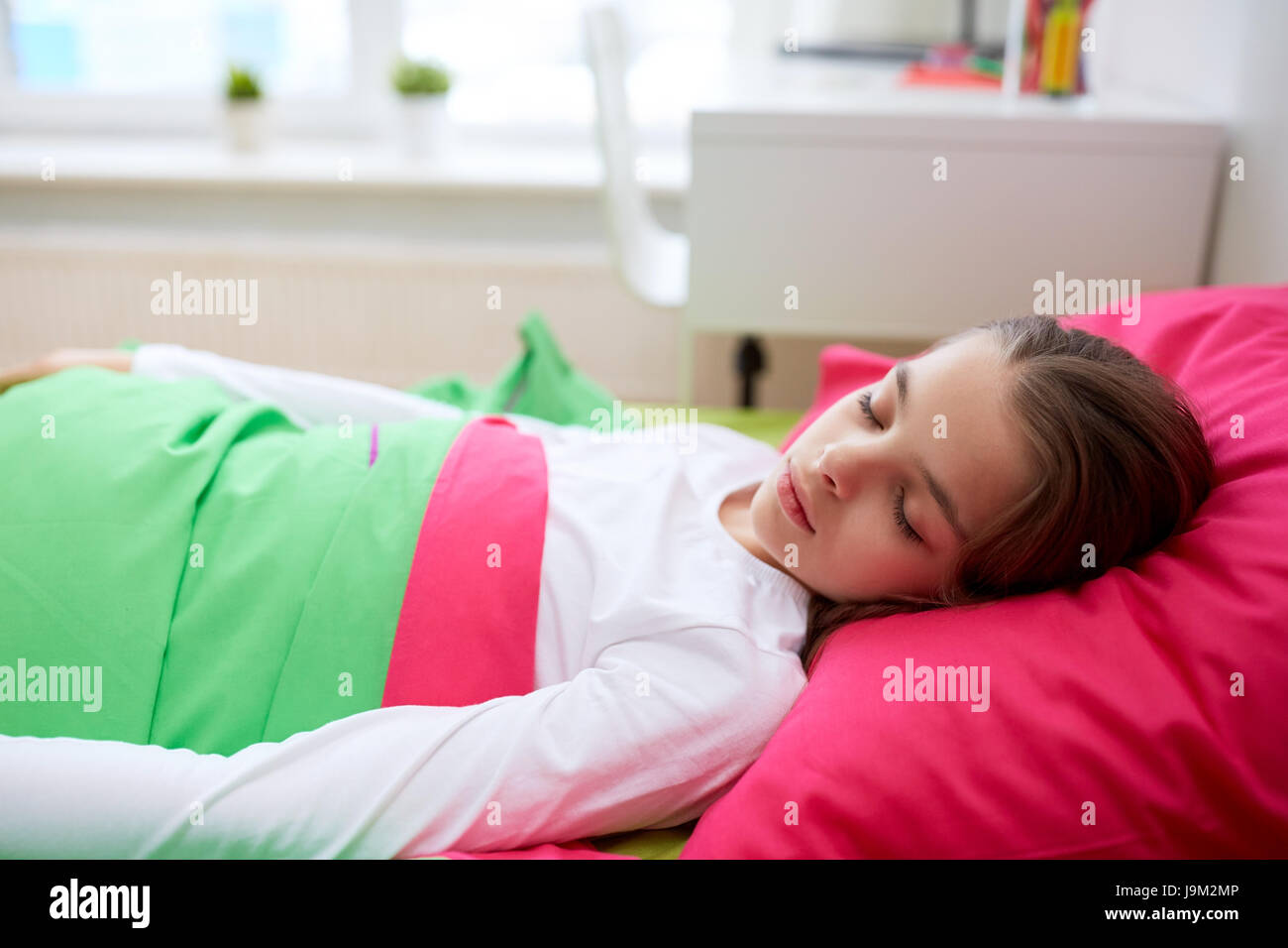 girl sleeping in her bed at home - Stock Image