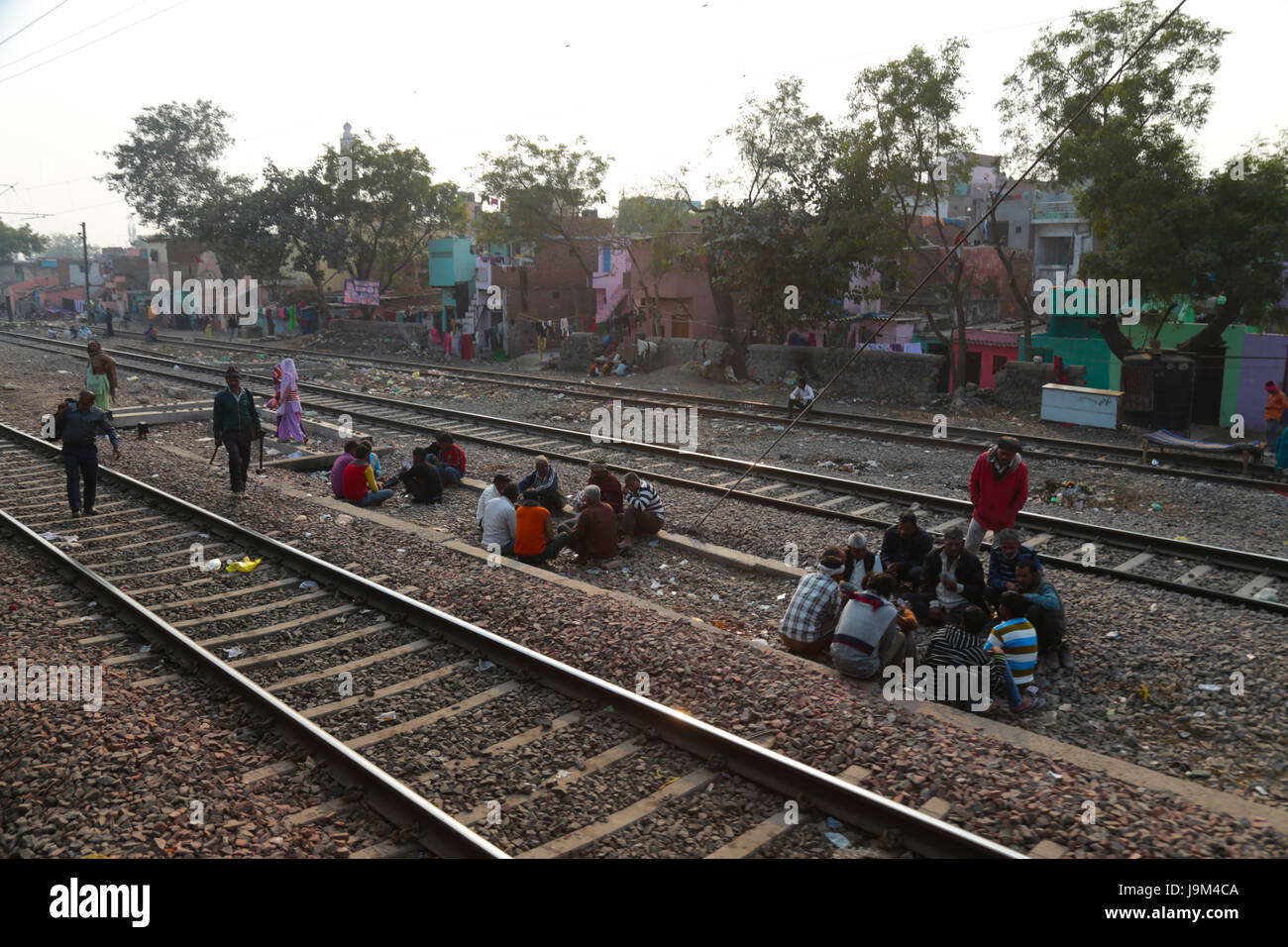 View on railway with people standing on the track from moving train. India Stock Photo