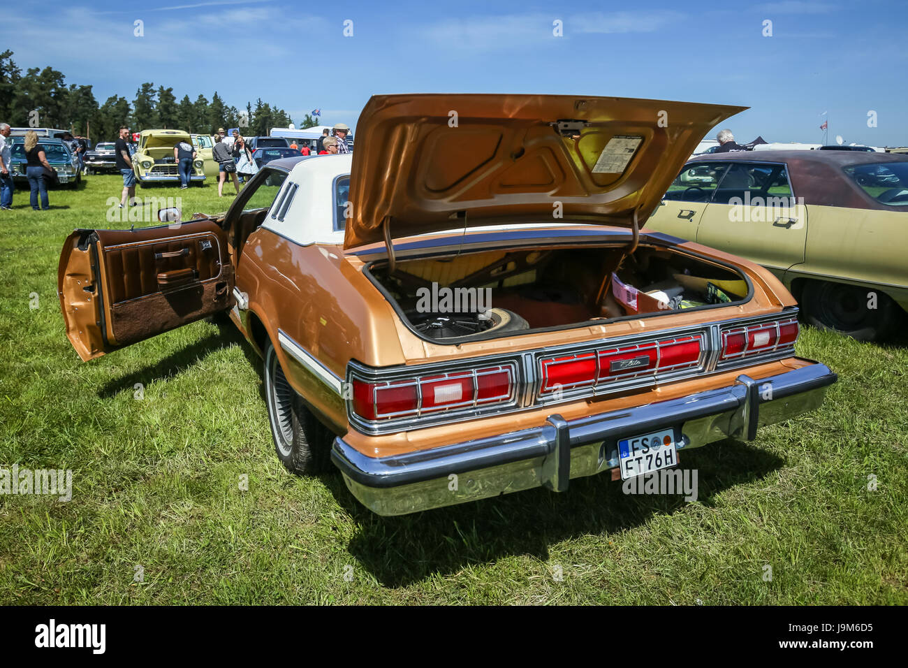 NANDLSTADT, GERMANY - MAY 6, 2017 : People sightseeing american automobile Ford Elite displayed at the US Car meeting - Stock Image