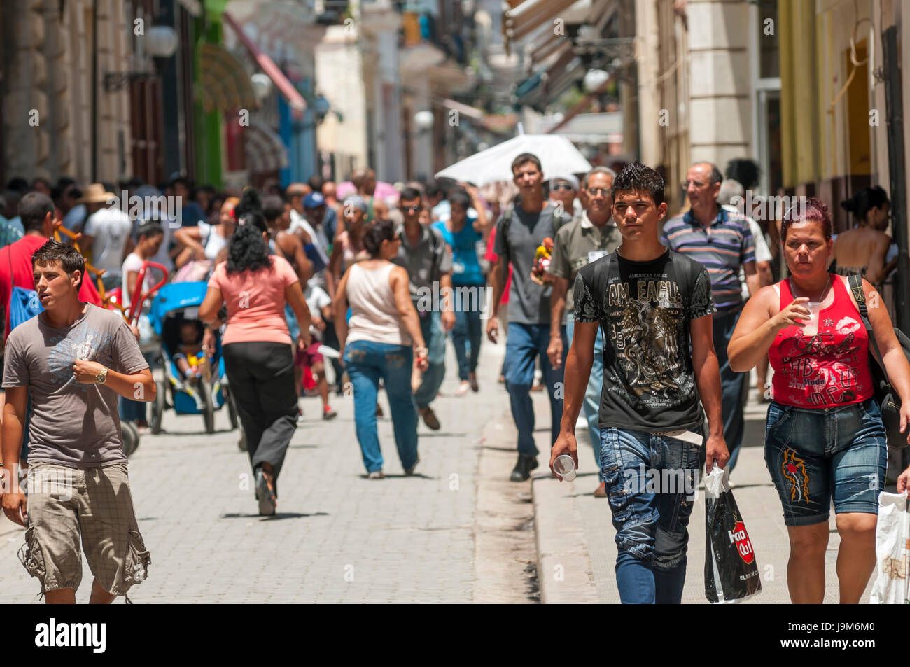 HAVANA - CIRCA JUNE, 2011: Pedestrians crowd the main shopping street, Calle Obispo, in the Habana Vieja neighborhood. - Stock Image