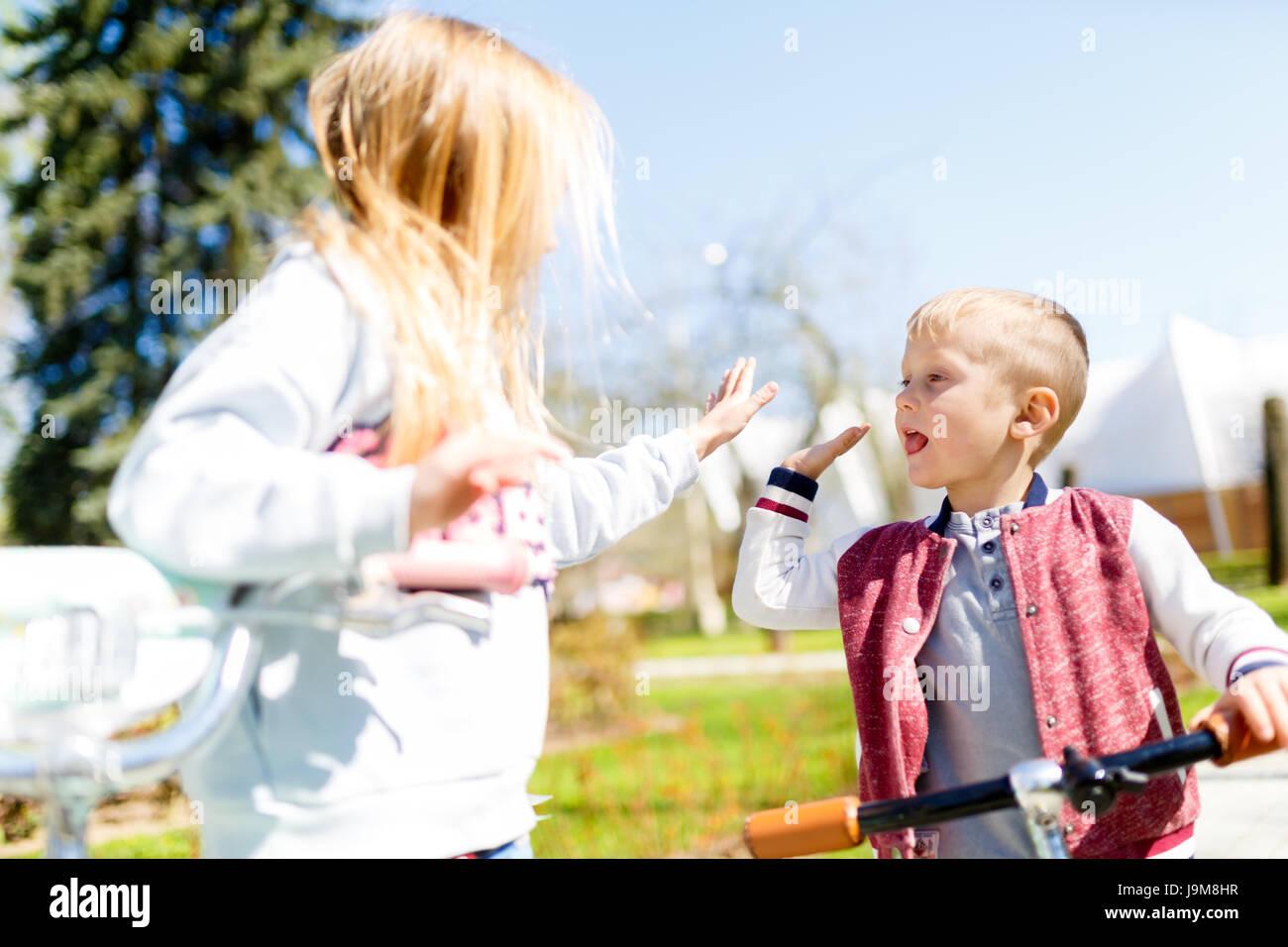 Boy with girl doing handshake - Stock Image