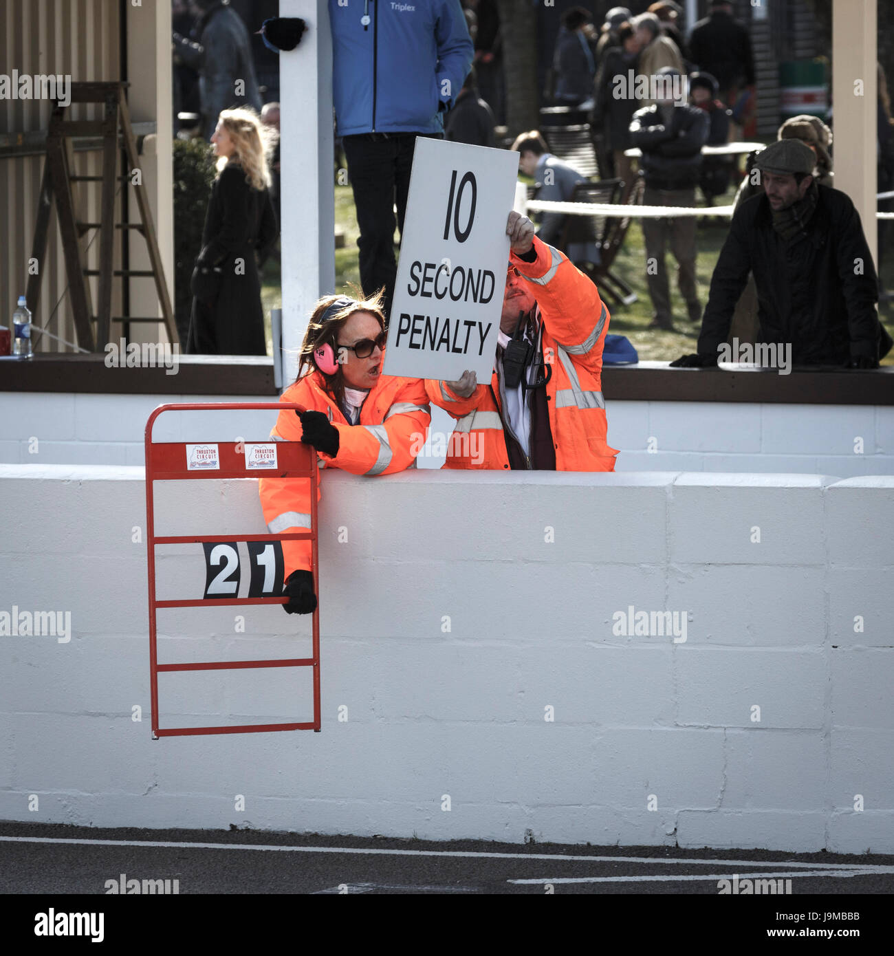 Race officials holding out the 10 Second Penalty board for car number 21 during the Gerry Marshall Trophy race at - Stock Image
