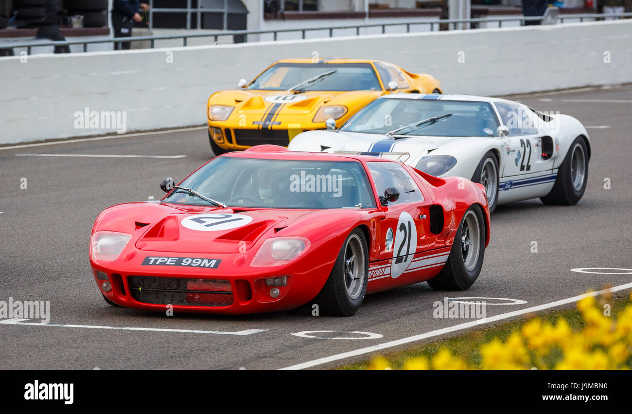 1966 Ford GT40 with driver Marc Devis on the grid for the Alan Mann Trophy race, Goodwood GRRC 74th Members Meeting, Stock Photo