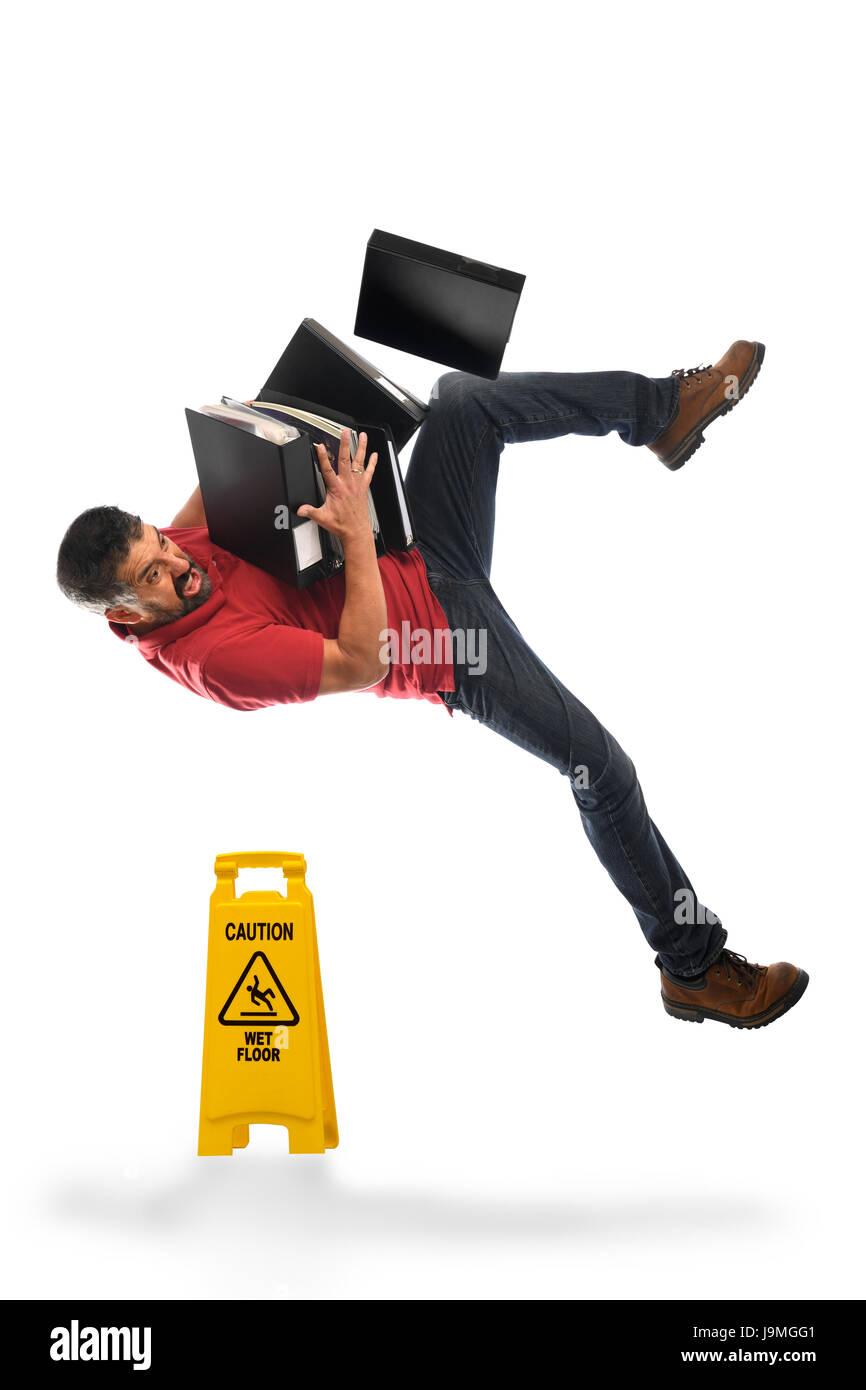 Businessman falling on Wet Floor isolated over white background - Stock Image