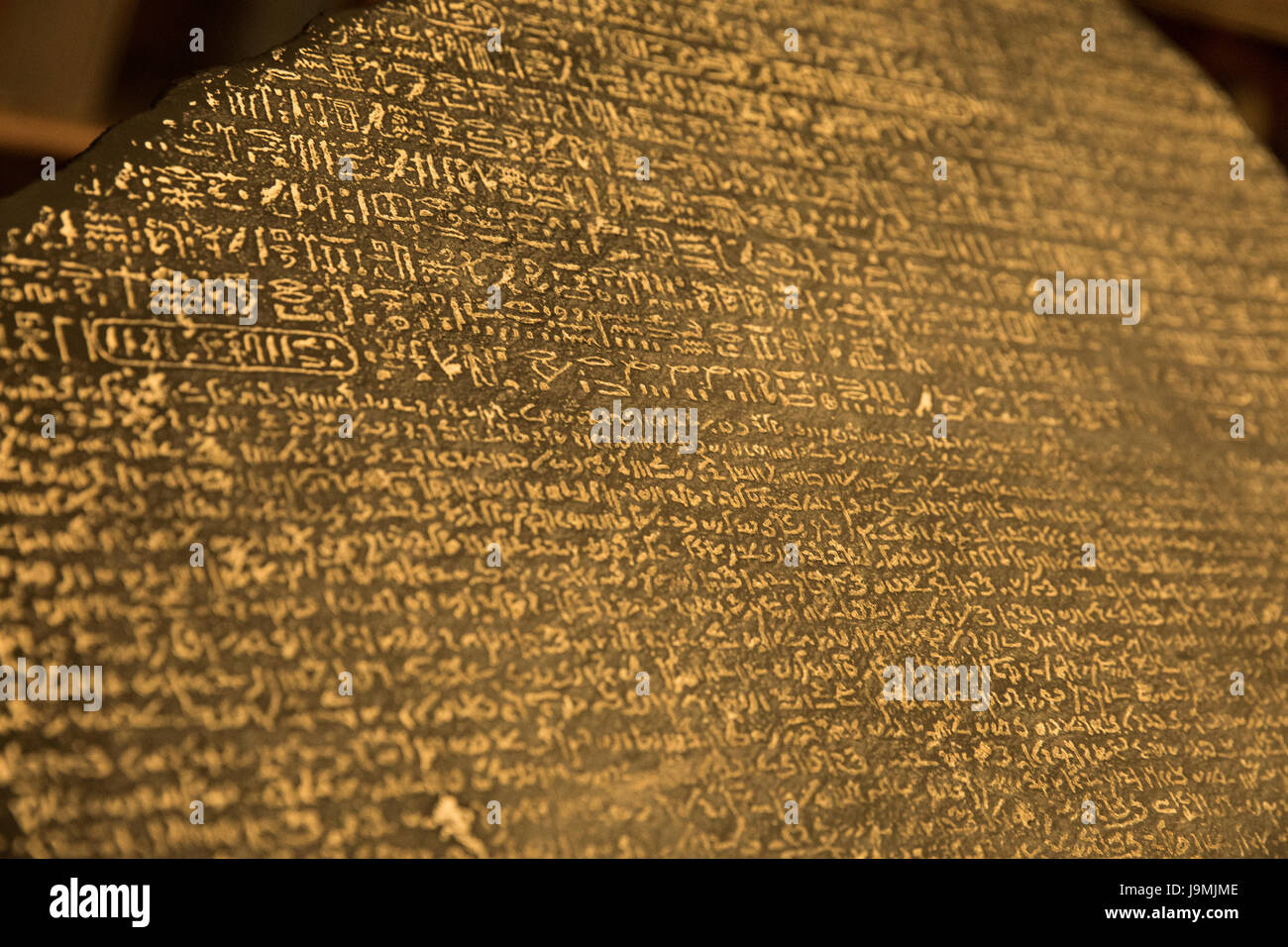 Egyptian hieroglyphs, demotic script, Ancient greek - Rosetta Stone, 196 BC, British Museum, London, England, UK - Stock Image