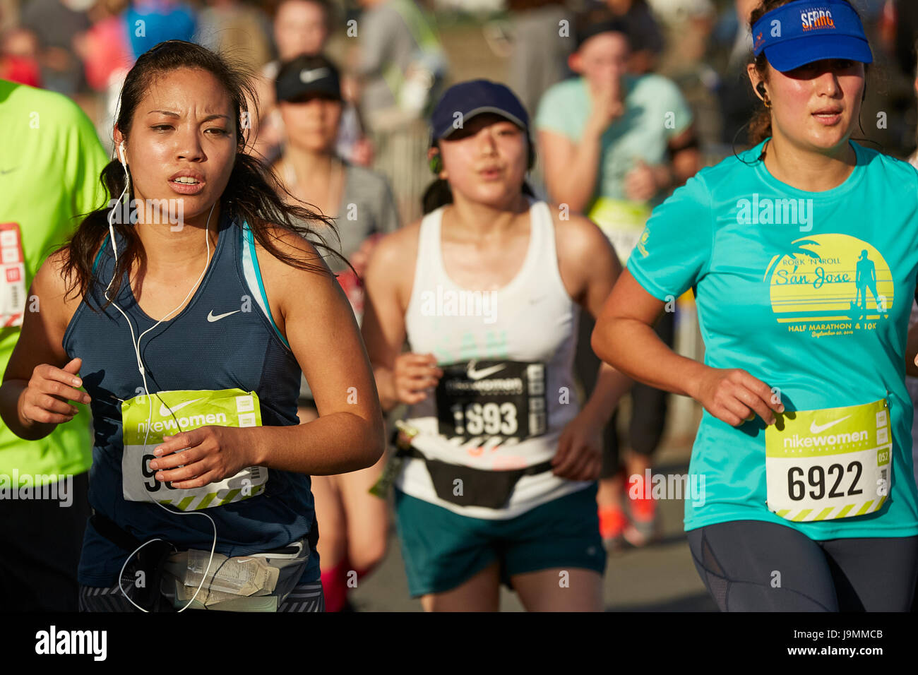 2333255ce61a Group Of Female Athletes Approaching The Finish Line In The Nike Woman s  Half Marathon