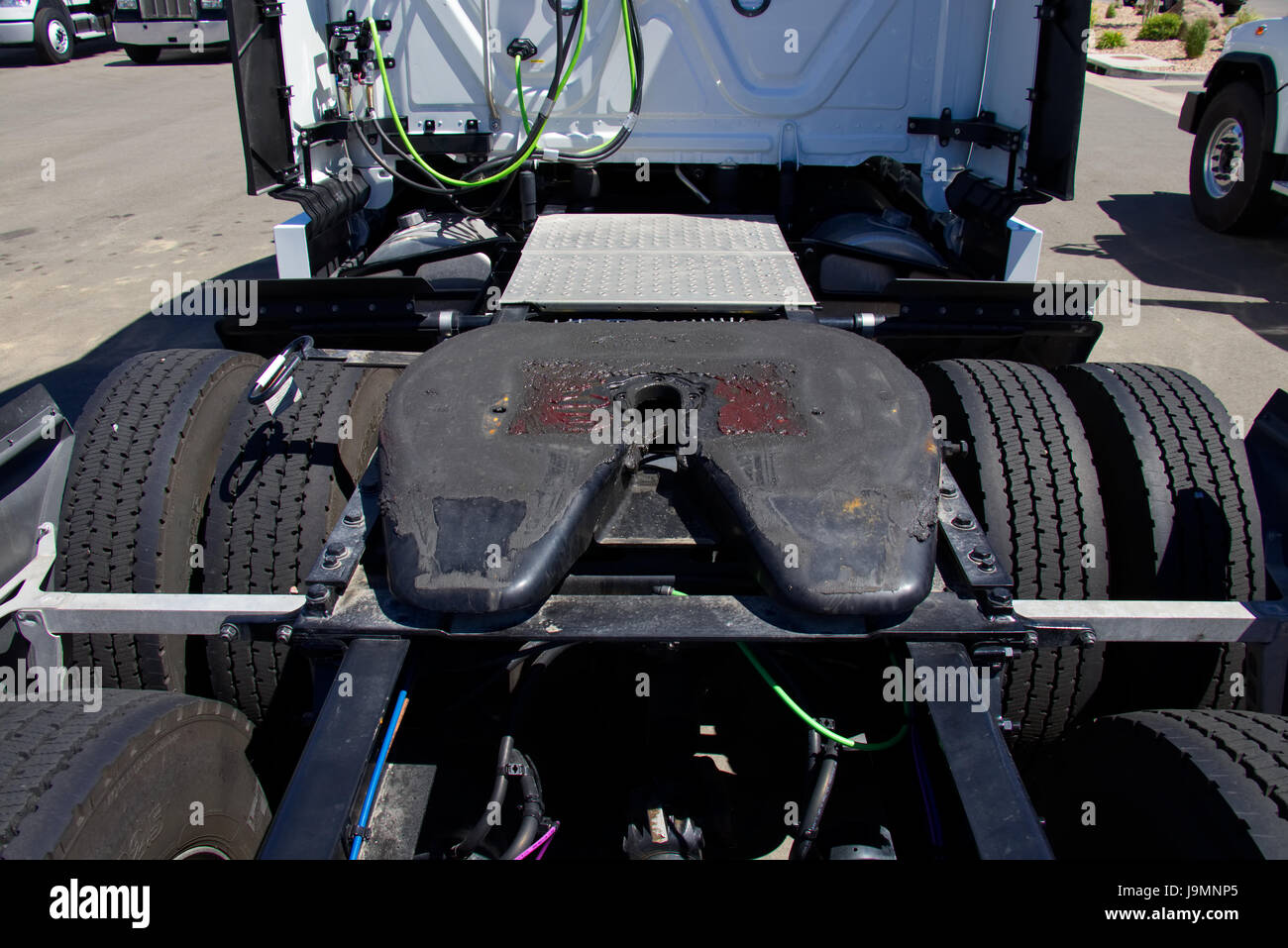 Row of Semi Trucks showing 5th Wheel Assemblies. - All Trademarks Removed. - Stock Image