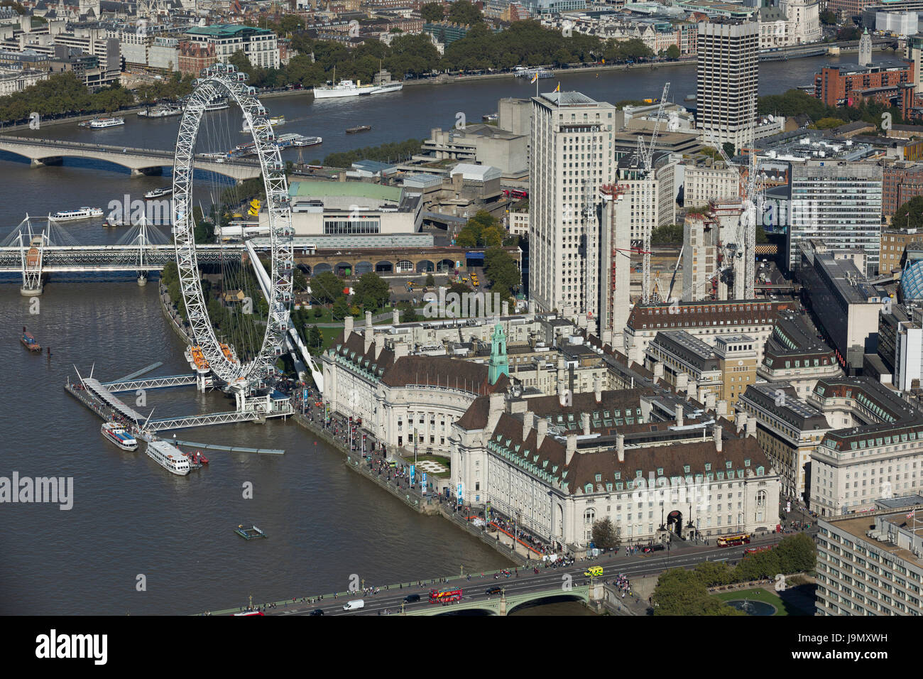 The London Eye sits on the South Bank of the River Thames. The Jubilee Gardens and County Hall Building. Lambeth, - Stock Image