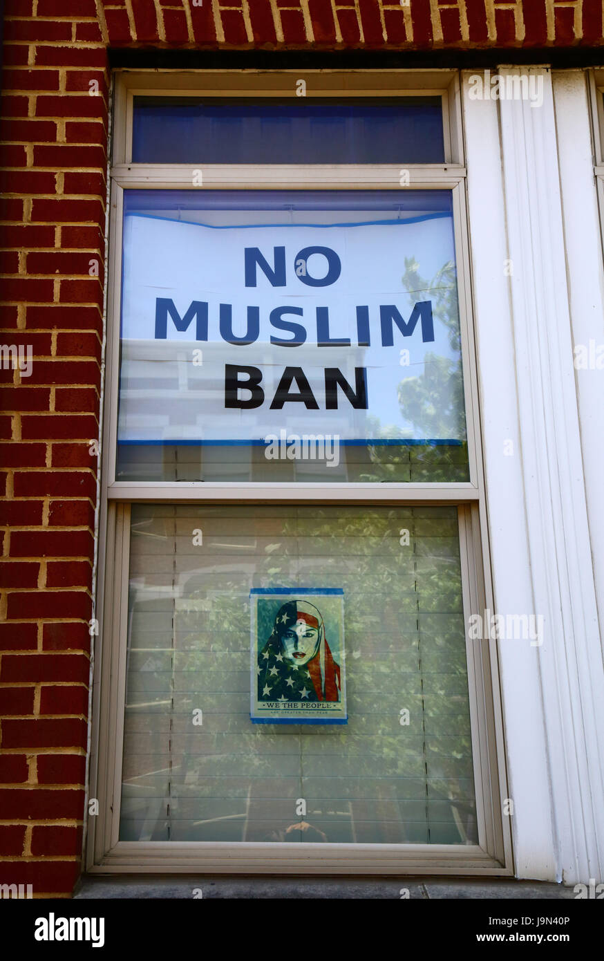 No Muslim Ban poster in  house window, Baltimore, Maryland, USA - Stock Image
