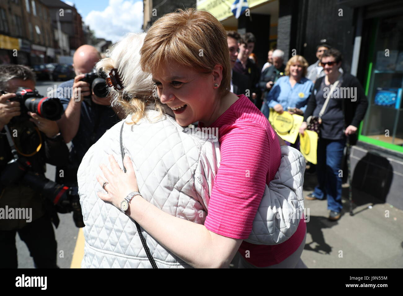 First Minister Nicola Sturgeon (right) is greeted by Helen, the mother of the SNP's local candidate Mhairi Black, Stock Photo