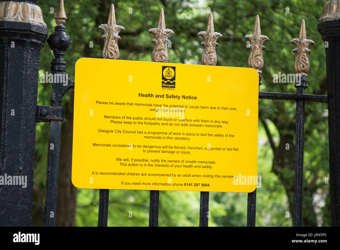 Glasgow Necropolis warning health and safety notice about the dangers of falling unsafe memorials gravestones - Stock Image