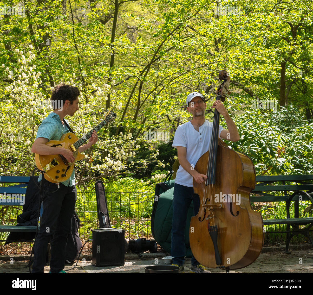 New York, NY USA -- April 28, 2017 -- An electric guitar and upright Bass player performing musically  in New York's Stock Photo