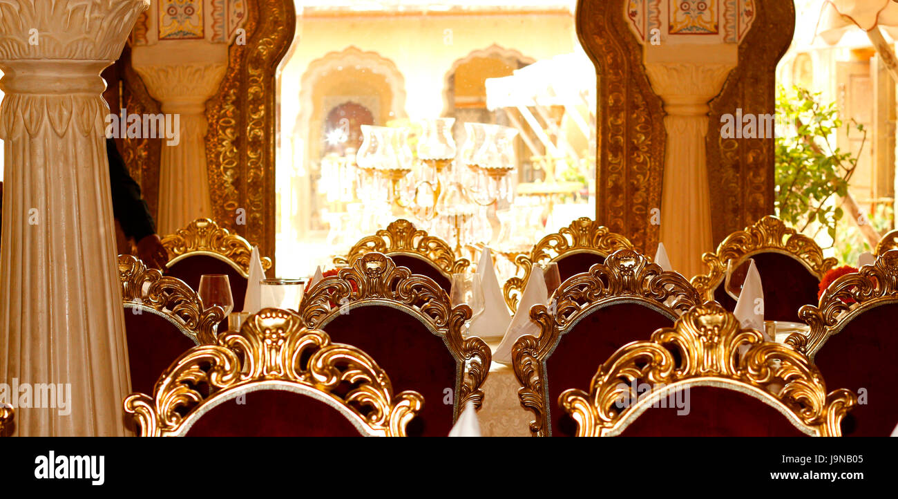 multiple Dinning table in 1135 AD restaurant inside Amber fort, Jaipur, Rajasthan, India interior - Stock Image